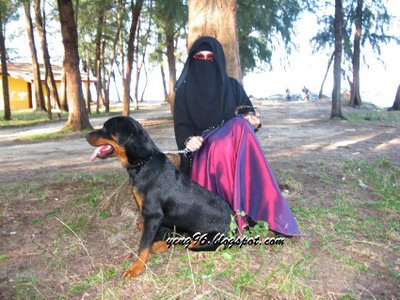 muhajibah with dog rottweiler